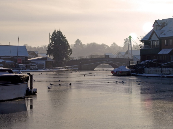 The River Bure frozen over with the Wroxham Bridge in the background. Credit: Gerry Balding