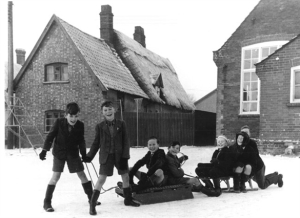 Can anyone identify any of these cheeky chappies playing in the snow in Harleston in the 1950s?