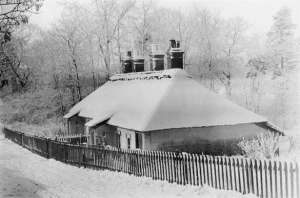 A Trowse cottage covered in snow back in the 19th century