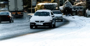 Driving with a build-up of snow on your bonnet and roof like this is potentially dangerous to you and other drivers, as it could suddenly dislodge at any time. Picture credit: Neil Watson